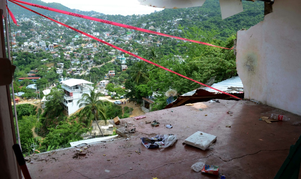 The wall of a home is missing after it fell during an earthquake in Acapulco, Wednesday, Aug. 21, 2013. The U.S. Geological Survey said the quake had a magnitude of 6.2 and was centered on the Pacific coast, near the resort of Acapulco.