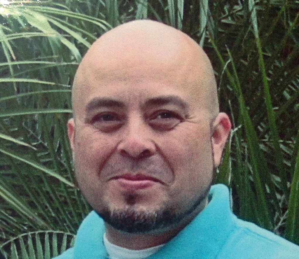 This June, 2013 photo released by the Hernandez family Saturday, Nov. 2, 2013, shows Transportation Security Administration officer Gerardo Hernandez.  Hernandez, 39, was shot to death and several others wounded by a gunman who went on a shooting rampage in Terminal 3 at Los Angeles International Airport Friday.