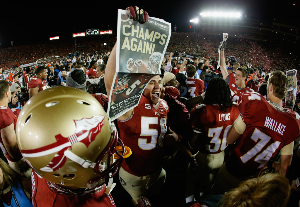 Offensive linesman Ryan Arnold #58 of the Florida State Seminoles celebrates after the Seminoles 34-31 victory against the Auburn Tigers during the 2014 Vizio BCS National Championship Game at the Rose Bowl on January 6, 2014 in Pasadena, California.