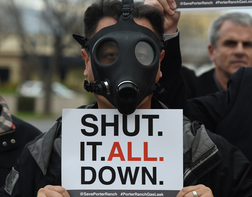A Porter Ranch resident wears a gas mask during a protest Saturday outside a meeting of the Air Quality Management Board over the Aliso Canyon gas leak. While regulators have ordered the gas company to shut down the leaking well, some residents want the entire facility shuttered.