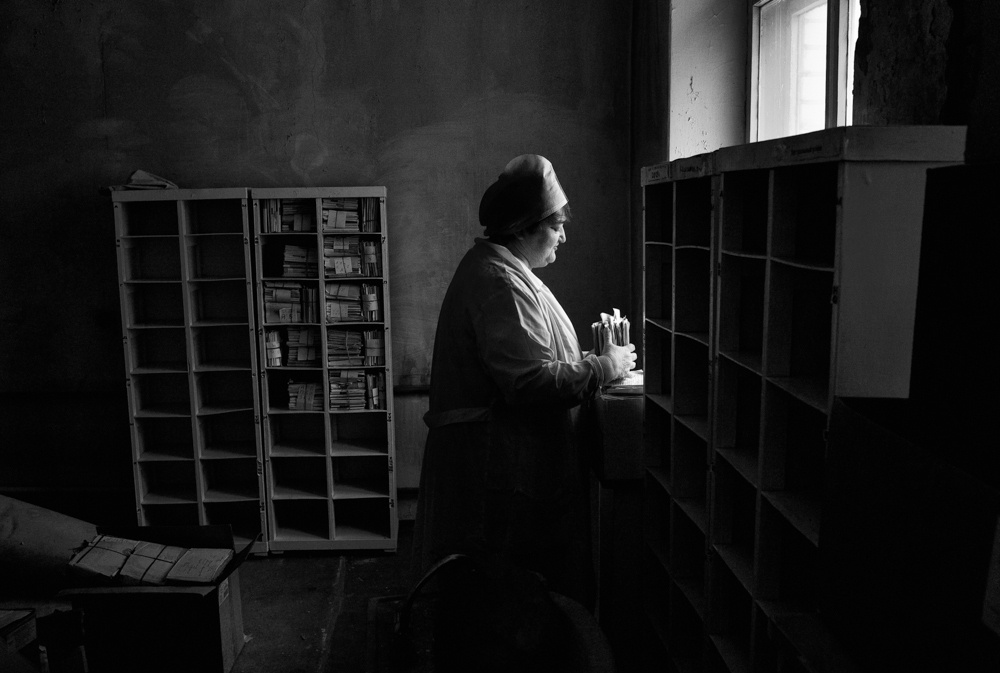 A nurse organizes the files of deceased patients at a TB hospital in Togliatti, Russia. Multi-drug resistant tuberculosis is a huge problem in the former Soviet Union.