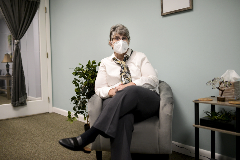 Jodee Pineau-Chaisson sits in her office in Springfield, Mass. on January 12, 2021. Pineau-Chaisson, a social worker, contracted the coronavirus last May and continues to have symptoms even months after testing negative for the virus.