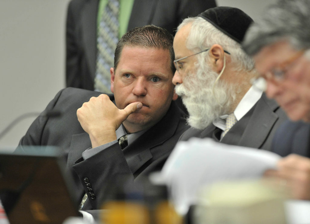 Fullerton police officer Jay Cicinelli confers with his defense attorney, Michael D. Schwartz during a preliminary hearing for the death of Kelly Thomas, on May 7, 2012.