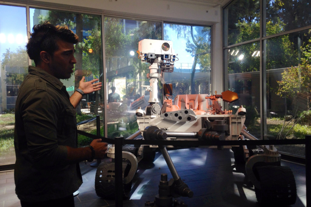Bobak Ferdowsi shows KPCCers a mock Curiosity at JPL.