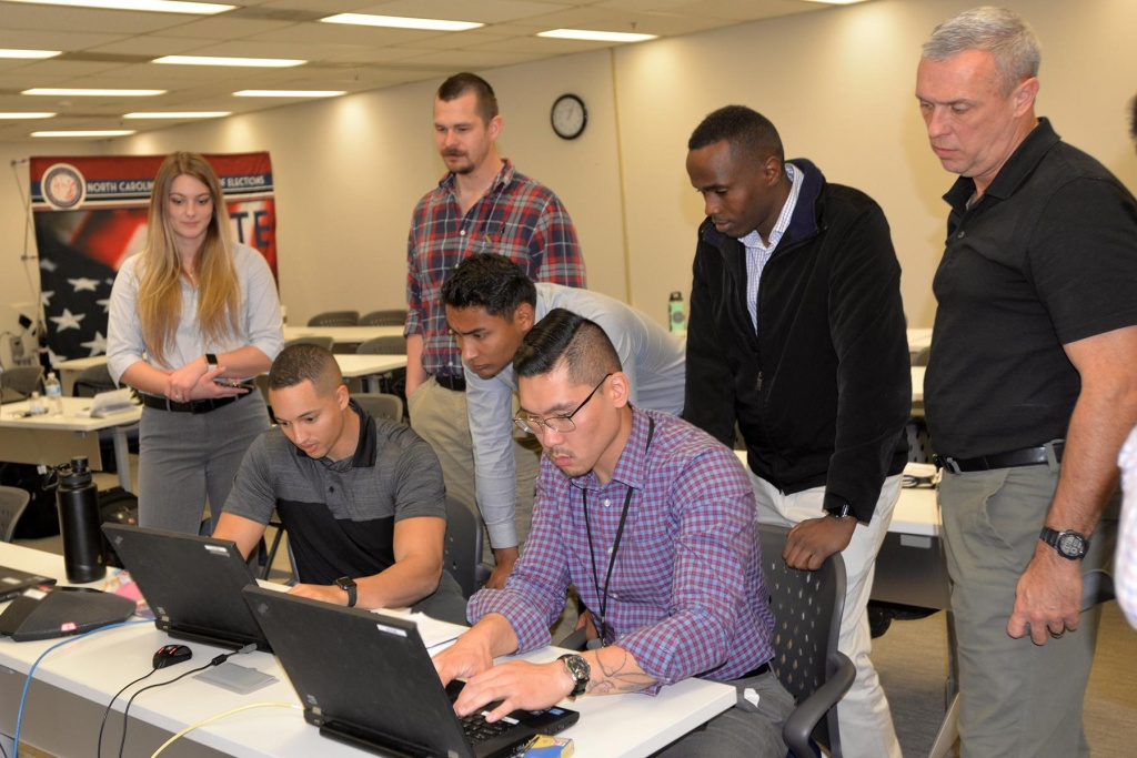 Members of the North Carolina National Guard Cyber Security Response Force test equipment at the State Board of Elections prior to the March 2020 primary.