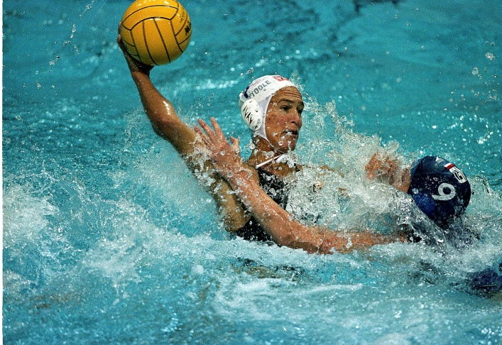 File: Maureen O''Toole #7 of Team USA passes the ball as Gillian Van Den Berg #9 of Team Netherlands tries to block her during the FINA World Cup at the Pan Am Pool in Winnepeg, Canada in May 1999.