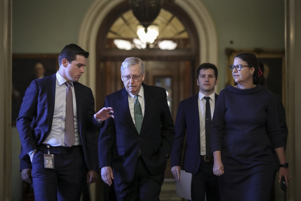A reporter asks questions as Senate Majority Leader Mitch McConnell (R-KY) leaves the Senate floor and walks to his office at the U.S. Capitol in Washington, DC.
