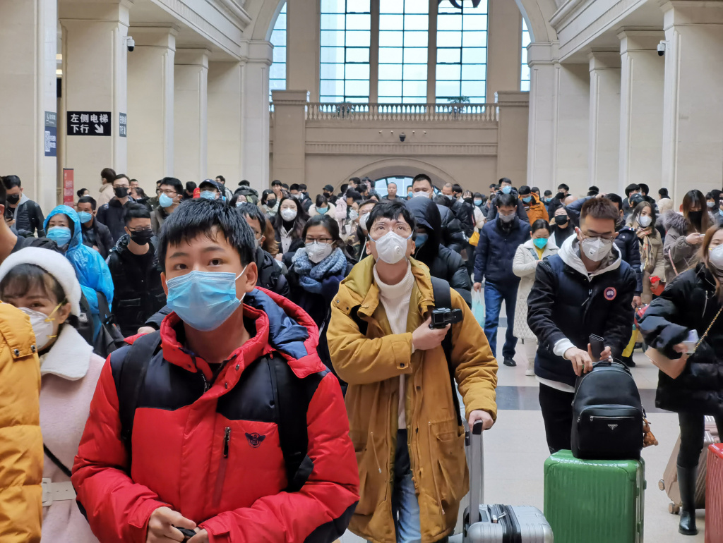 People wear face masks as they wait at Hankou Railway Station on January 22, 2020 in Wuhan, China. A new infectious coronavirus known as