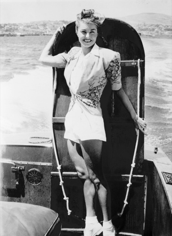 American movie star Esther Williams poses with a board as she is going to compete the