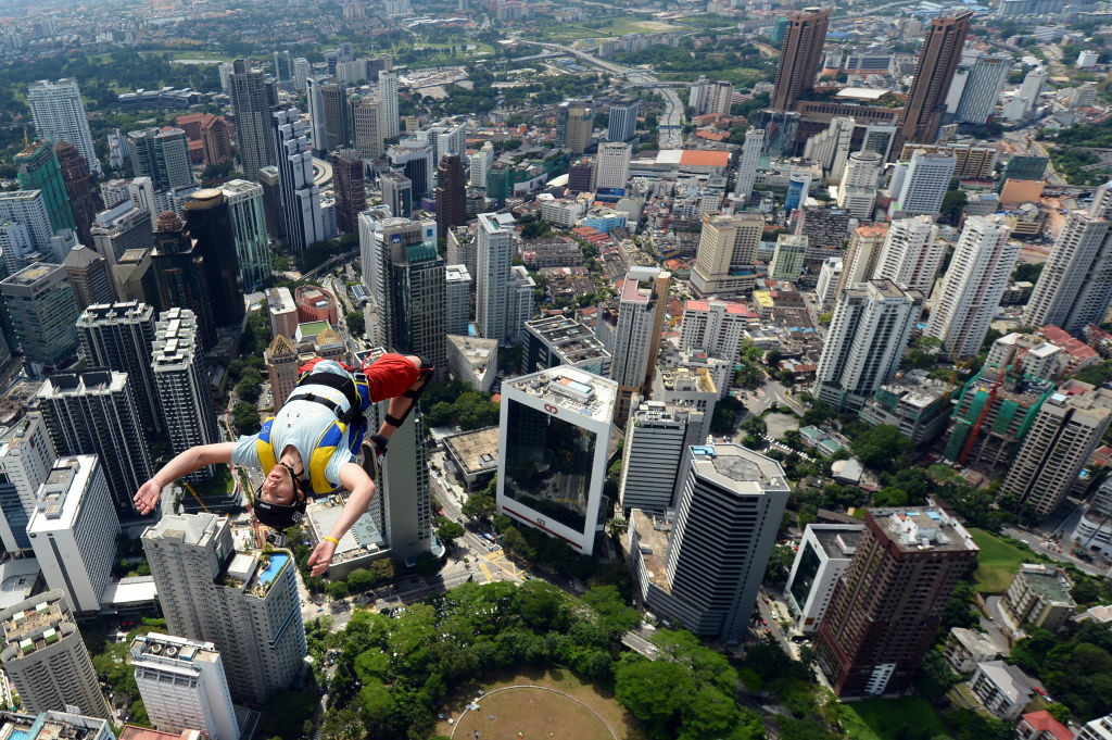 Base jumper Anton Chervyakov from Russia leaps from the top of the 421-metre Kuala Lumpur Tower during the International Tower Jump in Kuala Lumpur on September 27, 2012. Some 95 professional basejumpers from 18 countries are taking part in the annual event.