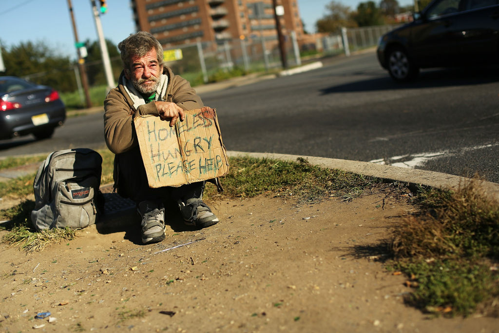 A homeless man named Bob waits for donations from passing motorists on October 11, 2012 in Camden, New Jersey.