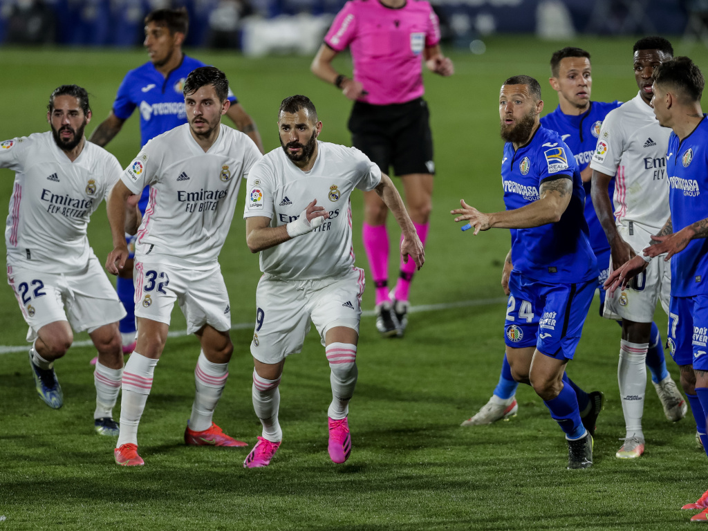Real Madrid players, left, duel with Getafe players during the Spanish La Liga soccer match at the Alfonso Perez stadium in Getafe, Spain, Sunday.