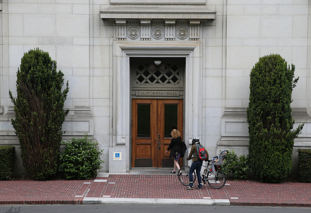 People enter California Hall on the UC Berkeley campus on May 22, 2014 in Berkeley, California.