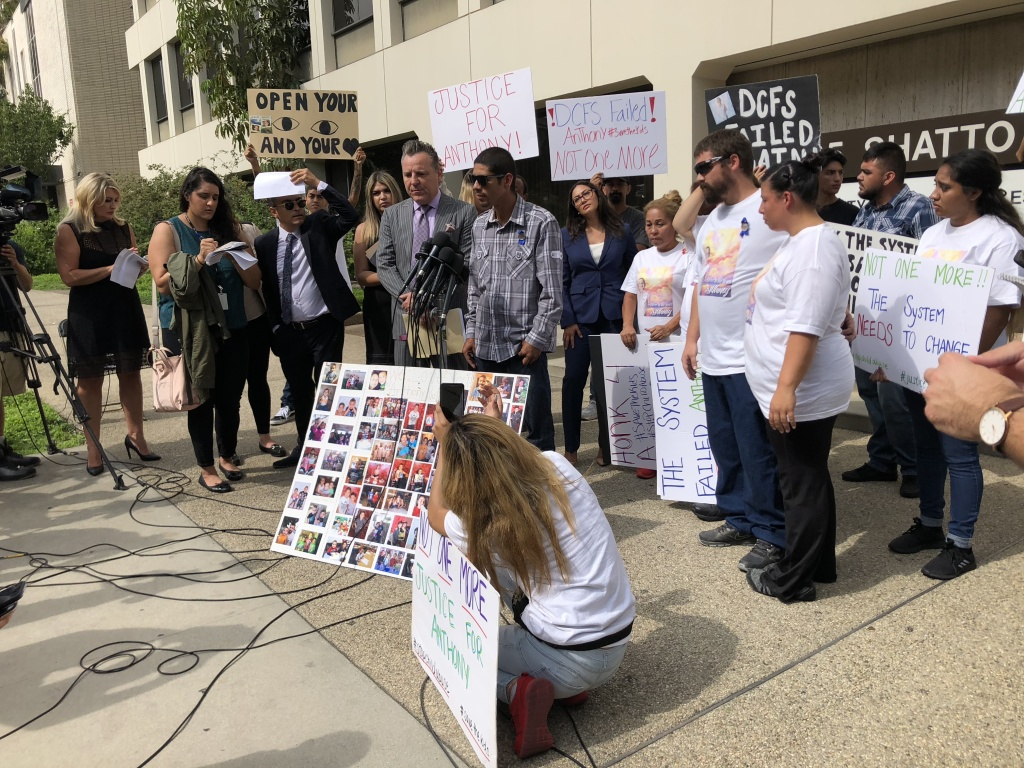 Activists stand in support as the family of 10-year-old Anthony Avalos accuses DCFS of negligence in protecting him.