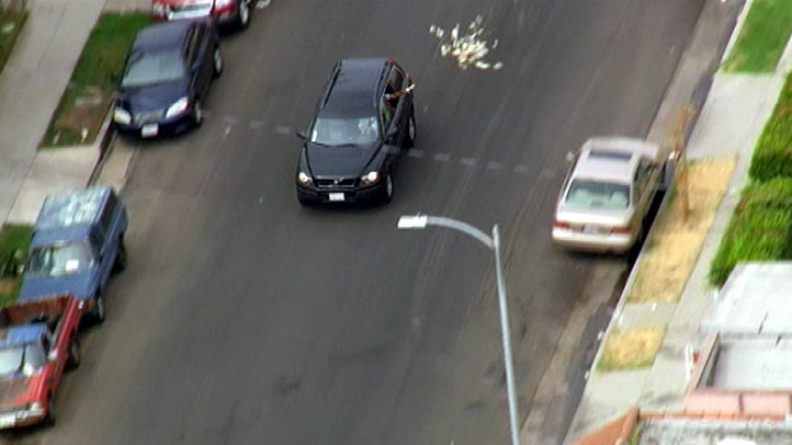 Suspected bank robbers tossed money from the window during a high-speed chase Wednesday, Sept. 12, 2012.