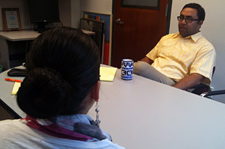 "UCLA undocumented student ""Sylvia"" meets with academic advisor Ernesto Guerrero. Both watched closely this week's Capitol Hill debate of the DREAM Act."
