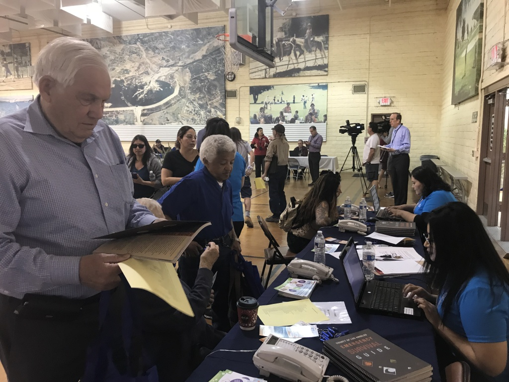 Richard Thompson (left) prepares to file a damages report at the local assistance center set up by Los Angeles city and county to assist victims of the Creek, Rye and Skirball fires. Some 60 homes, including his, burned down in the fires.