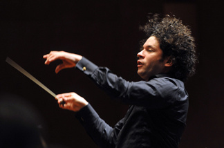 Venezuelan Music Director Gustavo Dudamel conducts 200 musicians of the Symphonic Orchestras from Colombia and of the Venezuelan Youth's Symphonic Orchestra Simón Bolívar during the presentation of the 'Concierto Sinfonico Binacional' (Binational Symphonic Concert) at the Teatro Mayor Julio Mario Santo Domingo´s theatre in Bogota, on December 15, 2010.