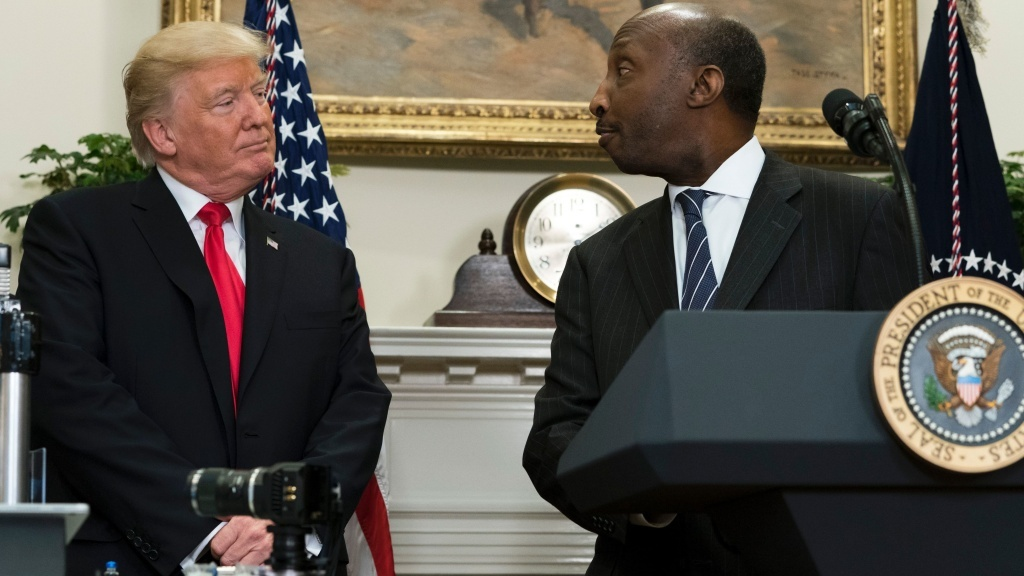 Kenneth Frazier, the CEO of Merck, said he was stepping down as a matter of personal conscience. He's seen here with President Trump during a White House event in July.