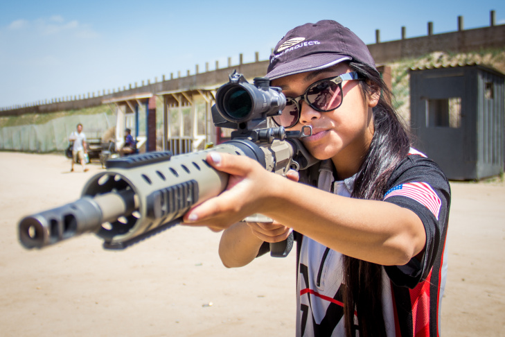 Claudia Vidanes aims a Phantom Strike AR-15, a custom gun designed by her father Jojo Vidanes, during a Norco Running Gun club practice at Raahauge's Shooting Park.