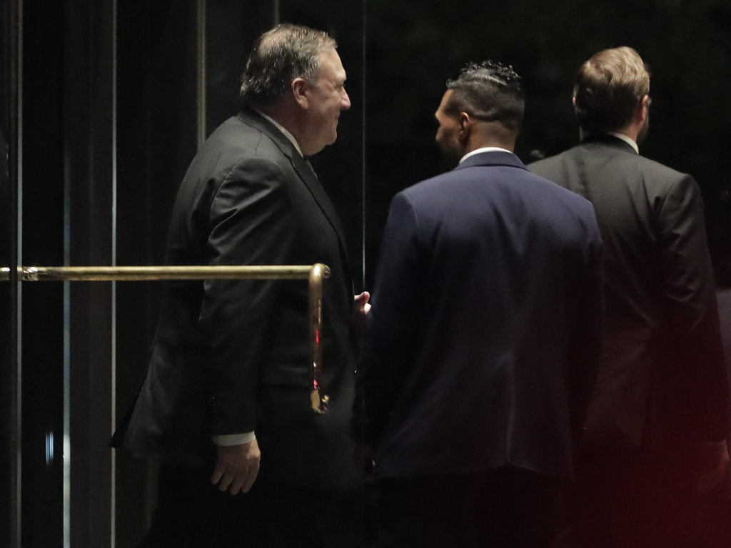Secretary of State Mike Pompeo, left, exits a residential building after meeting with Kim Yong Chol, former North Korean military intelligence chief and one of leader Kim Jong Un's closest aides, on Wednesday.