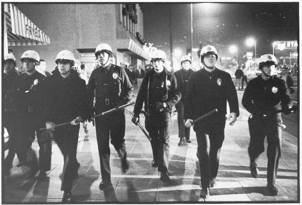 Police officers patrol Sunset Strip to control rioters in 1966.