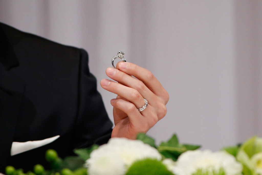 Hung-Chieh Chiang of Chinese Taipei shows their engagement ring during press conference on September 21, 2016 in Tokyo, Japan.
