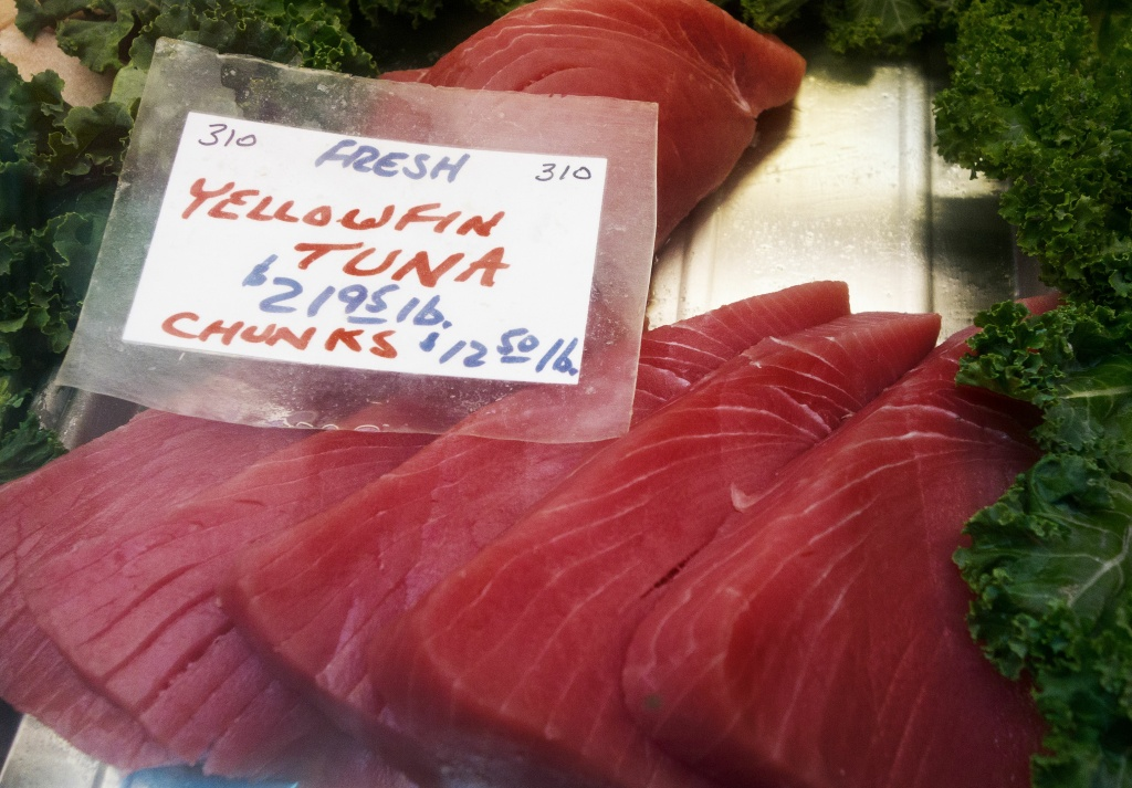 Yellowfin Tuna steaks are seen for sale at the Eastern Market February 25, 2014, in Washington, DC.