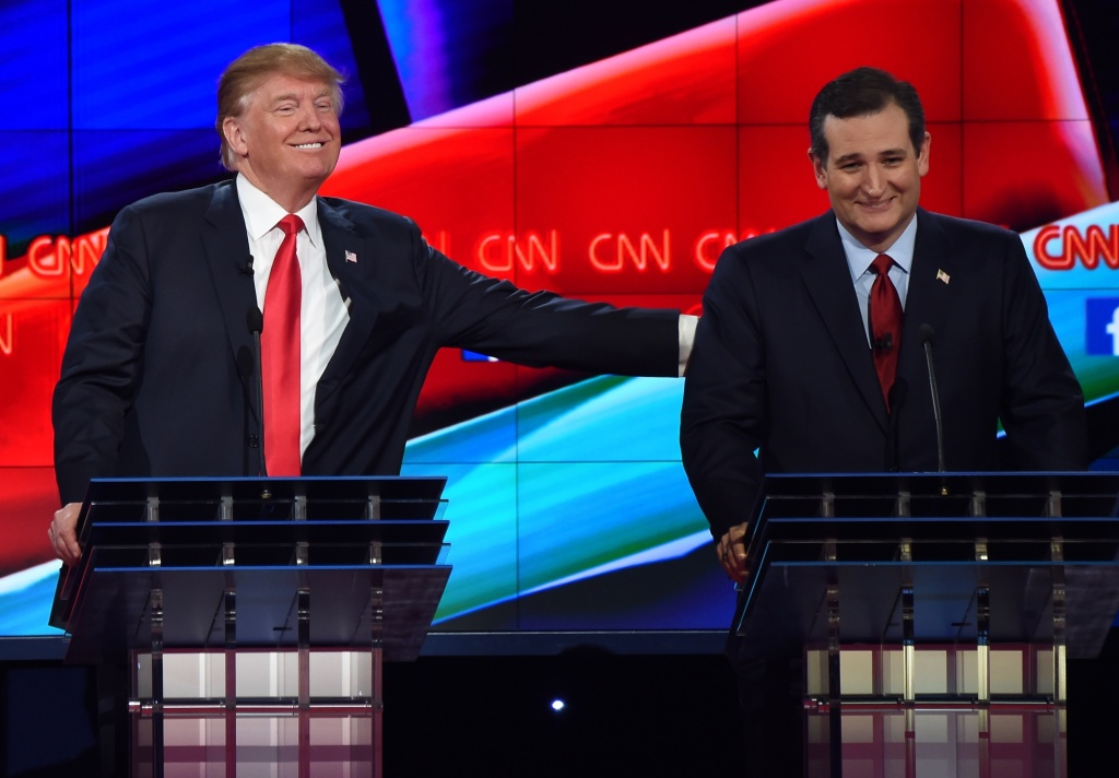 Republican presidential candidate businessman Donald Trump (L) pat the back of Texas Sen. Ted Cruz during the Republican Presidential Debate, hosted by CNN, at The Venetian Las Vegas on December 15, 2015 in Las Vegas, Nevada. AFP PHOTO/ ROBYN BECK / AFP / ROBYN BECK        (Photo credit should read ROBYN BECK/AFP/Getty Images)
