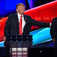Republican presidential candidate businessman Donald Trump (L) pat the back of Texas Sen. Ted Cruz during the Republican Presidential Debate.