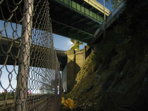 Alhambra police responded to calls Sunday morning about a body lying beneath an overpass near the train tracks. There were no signs of foul play, and police say it looks like a suicide.