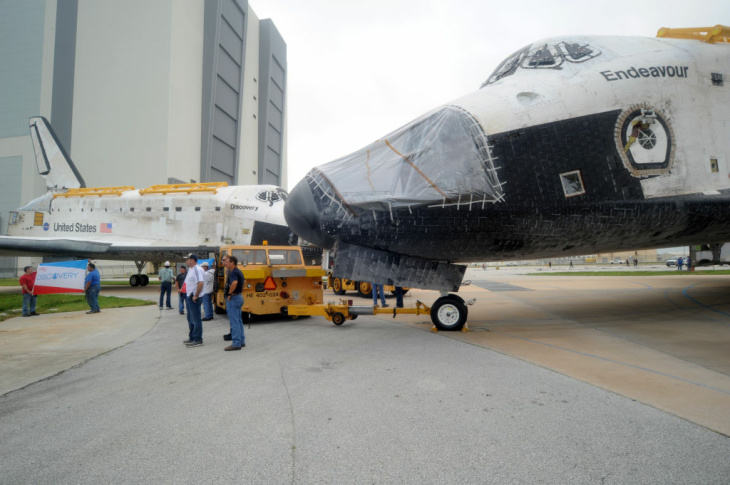 Space shuttle Endeavour sits atop the shuttle aircraft carrier after landing Wednesday, Sept. 19, 2012, at Ellington Field in Houston. Endeavour is making a final trek across the country to the California Science Center in Los Angeles, where it will be permanently displayed.