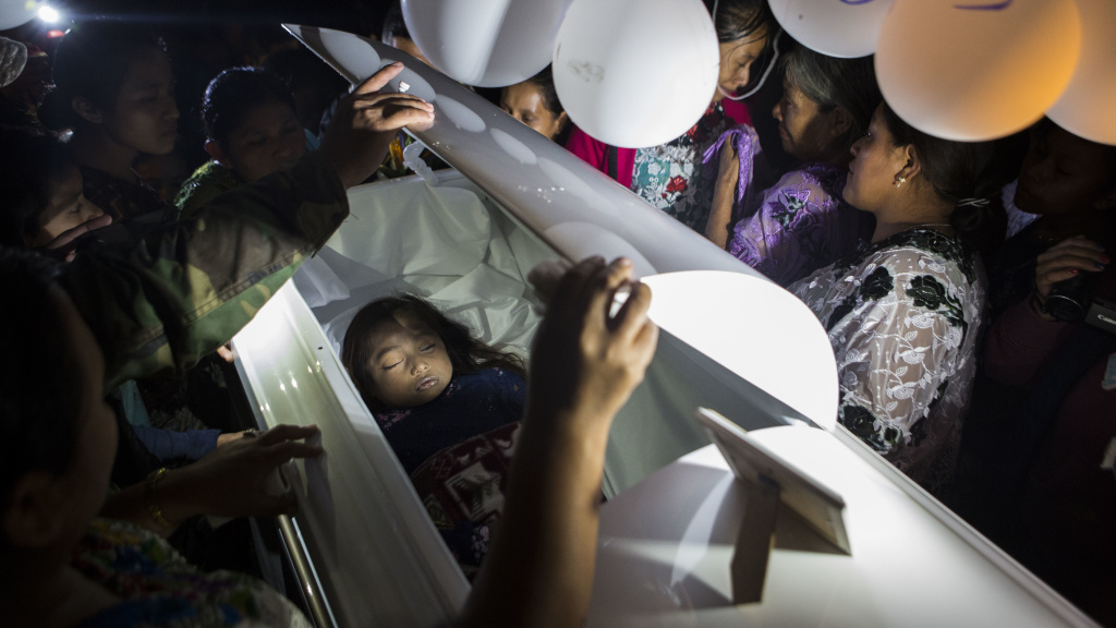 Family members pay their final respects to 7-year-old Jakelin Caal Maquin during a memorial service in Guatemala, on Dec. 24, 2018. Jakelin died while in the custody of U.S. Customs and Border Protection.