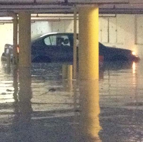 A broken water main flooded an apartment's garage Wednesday night, May 29, 2013.