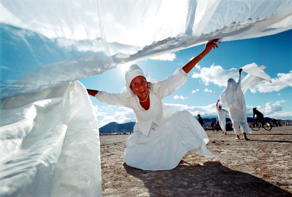 Madelaina Bolouc, of Boulder, Colorado, performs a dance of reverence to Orisha and Obatala on September 2, 2000 at the 15th annual Burning Man festival in the Black Rock Desert near Gerlach, Nevada.