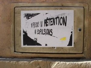 "A poster in French reading ""not prison, not retention, not expulsion (deportation)."""