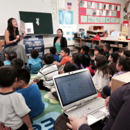 File: Norwalk preschool teacher Stefanie Servin reads to her class as her district coach, Astrid Feist, observes and takes notes from the back of the classroom.