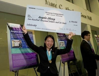 Angela Zhang, of Cupertino, holds aloft the winner's $100,000 scholarship check after being named the winner of the 2011 Siemens Competition in Math, Science and Technology.  Zhang, a senior at Monta Vista High School, designed an drug delivery system which would deliver the drug salinomycin to cancer stem cells, which she says are responsible for initiating and driving tumor growth. She hopes to major in chemical or biomedical engineering or physics and ultimately become a research professor.