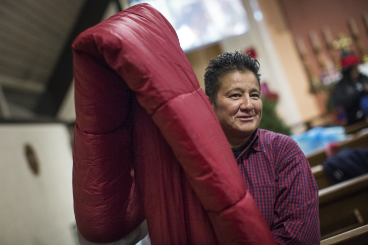 Sonia Sotelo gets ready for bed at All Saints' Episcopal Church in Highland Park on Tuesday night, Dec. 22, 2015. Every night until March, the church is opening their pews for people to sleep.