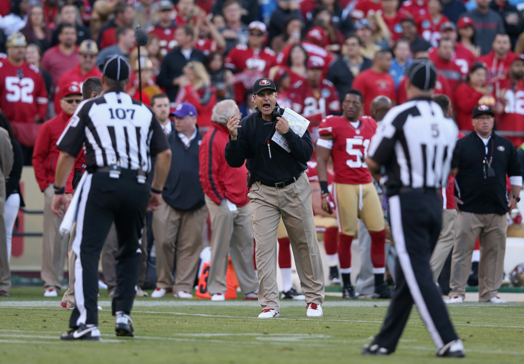 Head coach Jim Harbaugh of the San Francisco 49ers argues with referees during their game against the Detroit Lions at Candlestick Park on September 16, 2012 in San Francisco, California. On Monday night, the replacement refs may have lost the Green Bay Packers a game against the Seattle Seahawks.