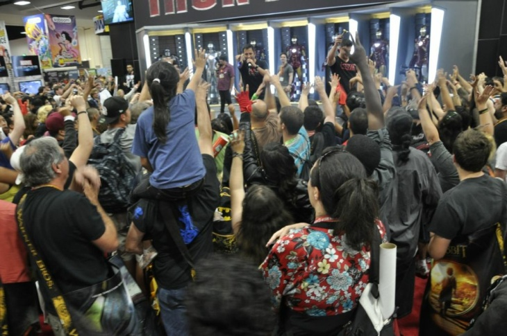 Rabid fans claw for giveaways at Marvel Comics' booth at San Diego Comic-Con 2012.