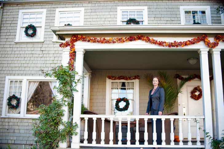 Jessica Susnar stands outside her Pasadena CalTrans-owned house. Susnar and her family have rented the late-1800's house from CalTrans since 2001.