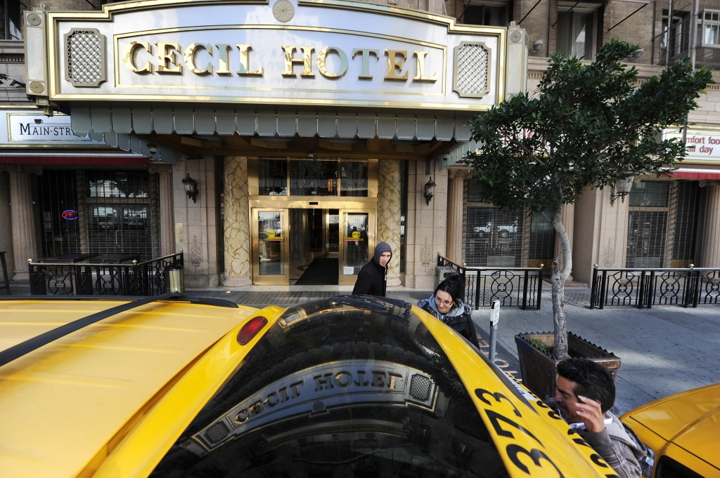 A taxi driver waits as British tourists Mike and Sabina Baugh, both 27, leave the Cecil Hotel on February 20, 2013, after the body of 21-year-old Canadian tourist Elisa Lam was found in a water tank on the roof of the hotel.