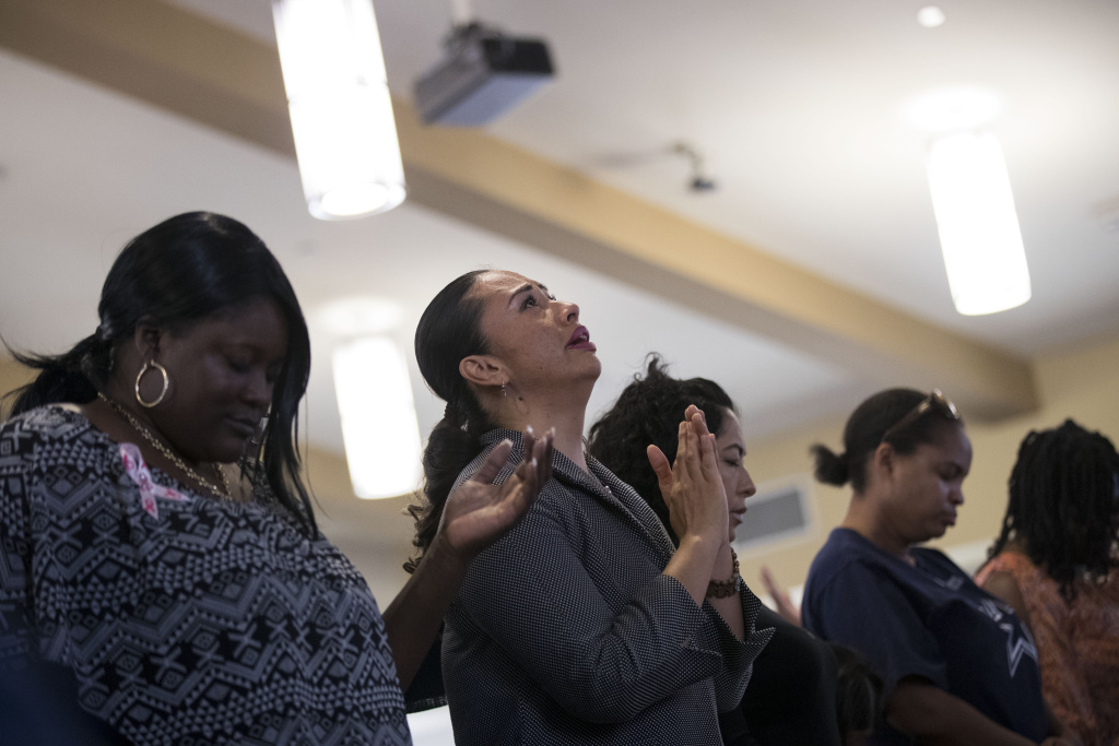LAS VEGAS, NV - OCTOBER 8: Worshippers pray during a special 'Healing Through Celebration' afternoon service at First African Methodist Episcopal Church Las Vegas, on October 8, 2017 in North Las Vegas, Nevada. On October 1, Stephen Paddock killed at least 58 people and injured more than 450 after he opened fire on a large crowd at the Route 91 Harvest country music festival. The massacre is one of the deadliest mass shooting events in U.S. history. (Photo by Drew Angerer/Getty Images)