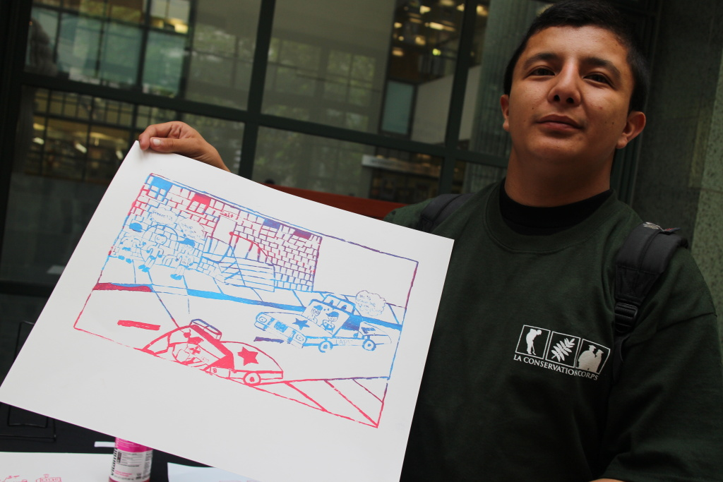 Raul Gomez, 18, goes to Saito High School. He made a screen print that depicts racial profiling. He appreciates art because,