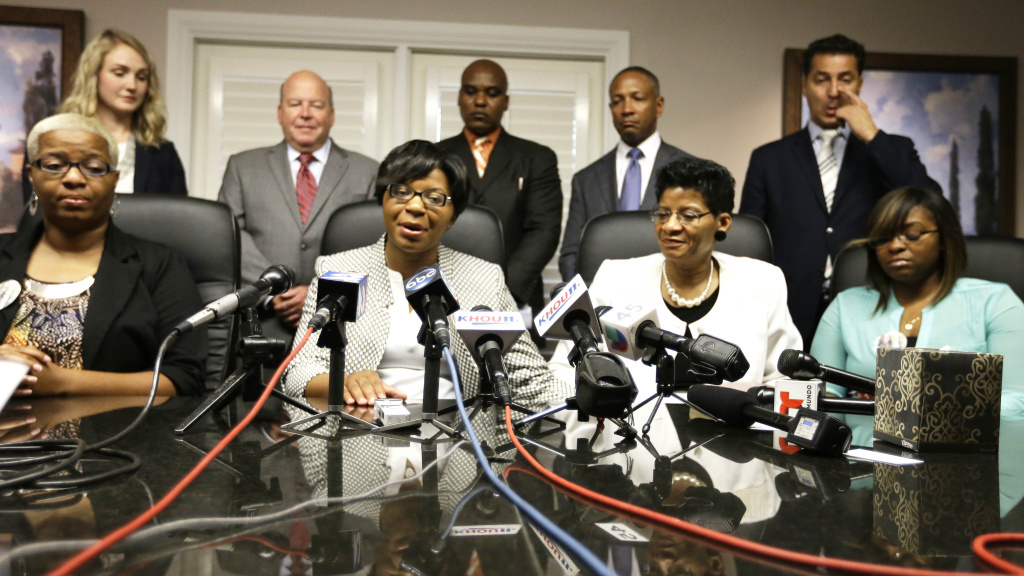 The family of Sandra Bland holds a news conference Tuesday, Aug. 4, 2015, in Houston. Bland's family has filed a wrongful-death lawsuit Tuesday against the officer and other officials, saying it was a last resort after being unable to get enough information about the case. Bland, a 28-year-old Chicago-area woman, was found dead in her Waller County jail cell in Hempstead, Texas on July 13.