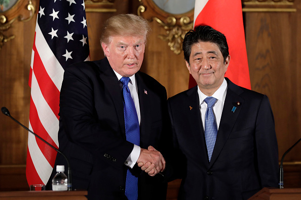 US President Donald Trump shakes hands with Japan's Prime Minister Shinzo Abe (R) during a news conference at Akasaka Palace in Tokyo on November 6, 2017.