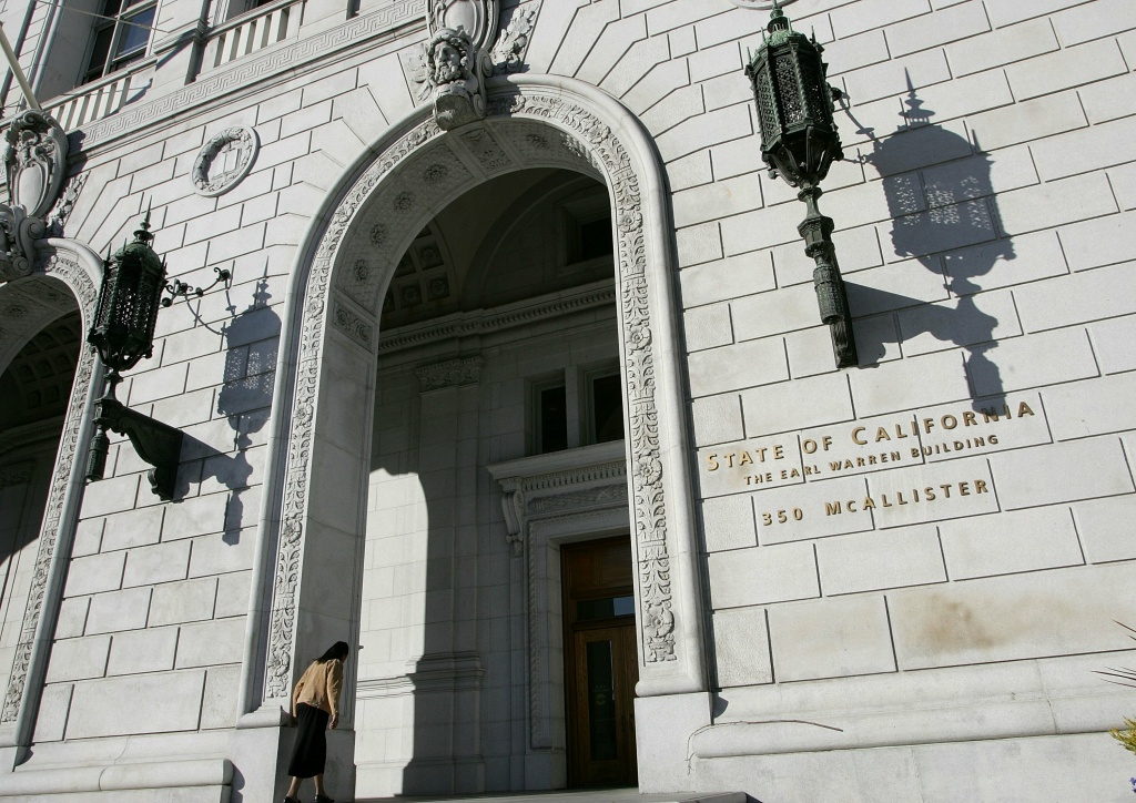 A woman walks into the State of California Earl Warren building Jan. 22, 2007, in San Francisco, Calif. The Supreme Court heard arguments on Thursday regarding the placement of property tax revenue.