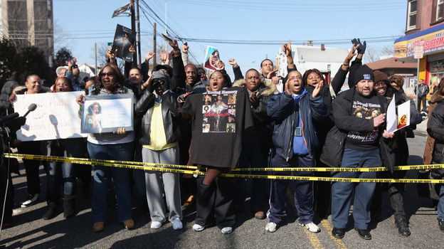Fans mourn outside the funeral service for singer Whitney Houston in Newark, N.J., on Saturday. The pop superstar was found dead in a California hotel room a week ago. The cause of death has yet to be determined.