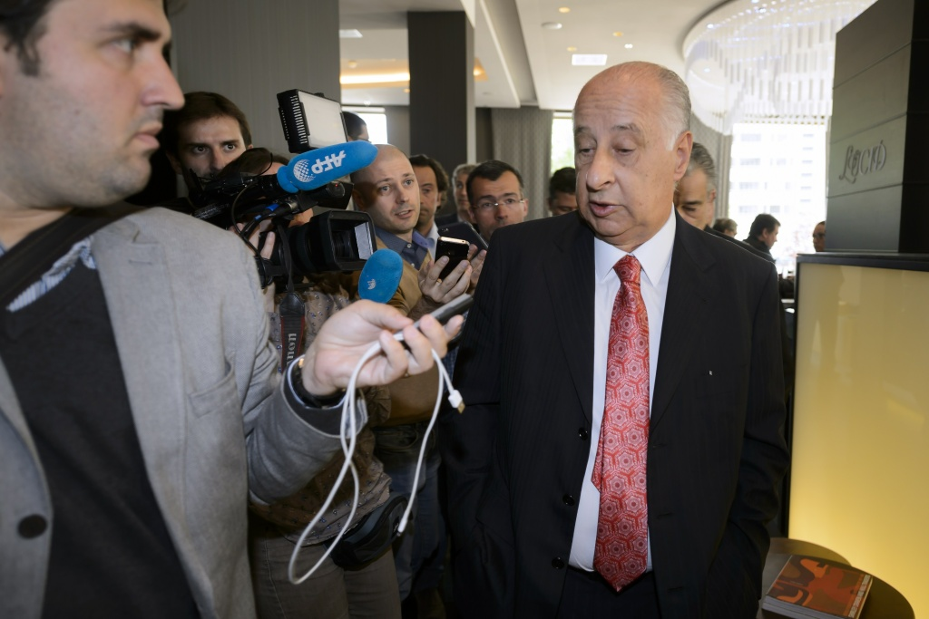 President of the Brazilian Football Confederation (CBF), Marco Polo del Nero is surrrounded by journalists during a session of the Conmebol on May 27, 2015 in Zurich. The dawn detention of several FIFA leaders and a corruption raid on its headquarters on Wednesday rocked world football's governing body two days before its leader Sepp Blatter seeks a new term.